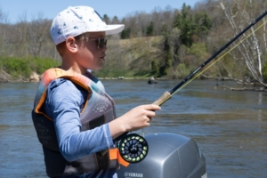 Kid fishing planter brown trout